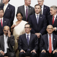 Group of 20 finance ministers and central bank governors get ready for a family photo in Fukuoka on June 9. | BLOOMBERG