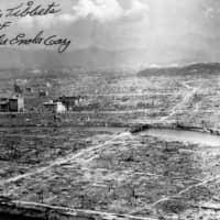 An image of Hiroshima, destroyed after the nuclear bomb of Aug. 6, 1945, with the autograph of 'Enola Gay' bomber pilot Paul Tibbets. | VIA WIKIMEDIA COMMONS (PUBLIC DOMAIN)