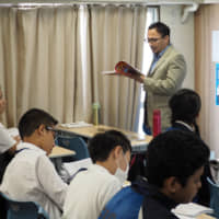 The day's lessons: Junior high school students learn social studies at Everest International School, Japan. | KYODO