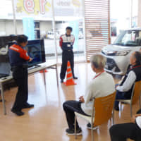 Gearing up: Elderly drivers attend a road safety class in Mie Prefecture in 2017. | KYODO