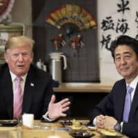 Despite Prime Minister Shinzo Abe's efforts to build a strong rapport with Donald Trump, the U.S. president hasn't softened his position on bilateral trade and security issues. | BLOOMBERG