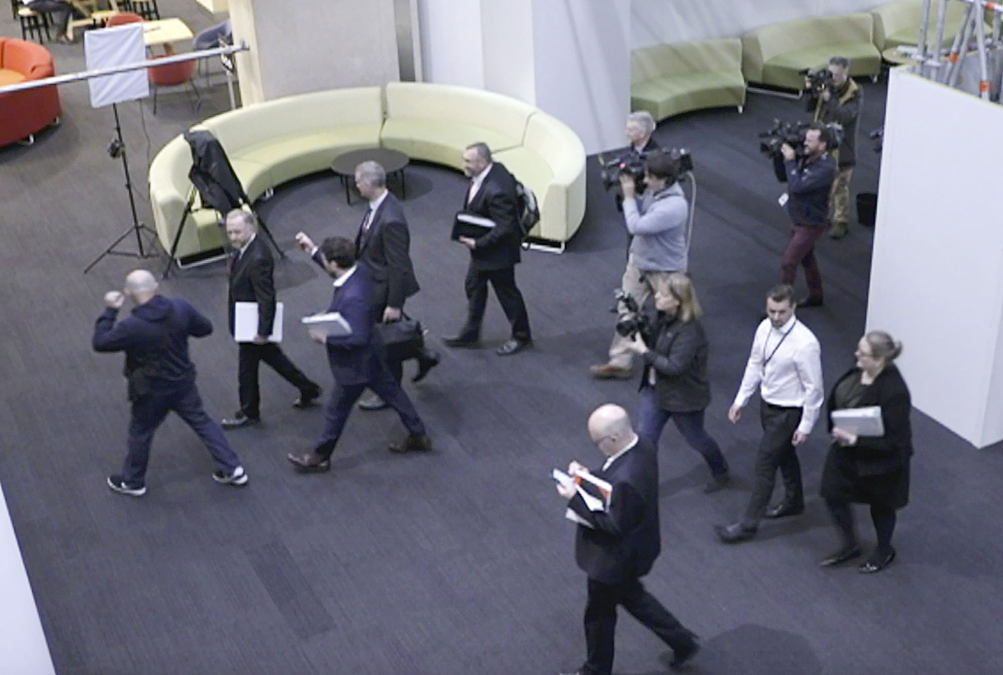 The Australian Federal Police raid the Australian Broadcasting Corporation's offices on June 5 in connection with the ABC's 2017 reporting on possible unlawful killings by Australian commandos in Afghanistan. | AP