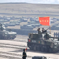 Chinese PLZ-07 self-propelled howitzers participate in Vostok 2018 in September. The Russian military exercise, the largest the world has seen since the end of the Cold War, was conducted on the Siberian border between Russia and China. | WWW.KREMLIN.RU