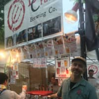 Valuing experimentation: Jason Koehler, one of craft beer company DevilCraft's three founders, poses in front of a DevilCraft booth. | JEREMY WILGUS