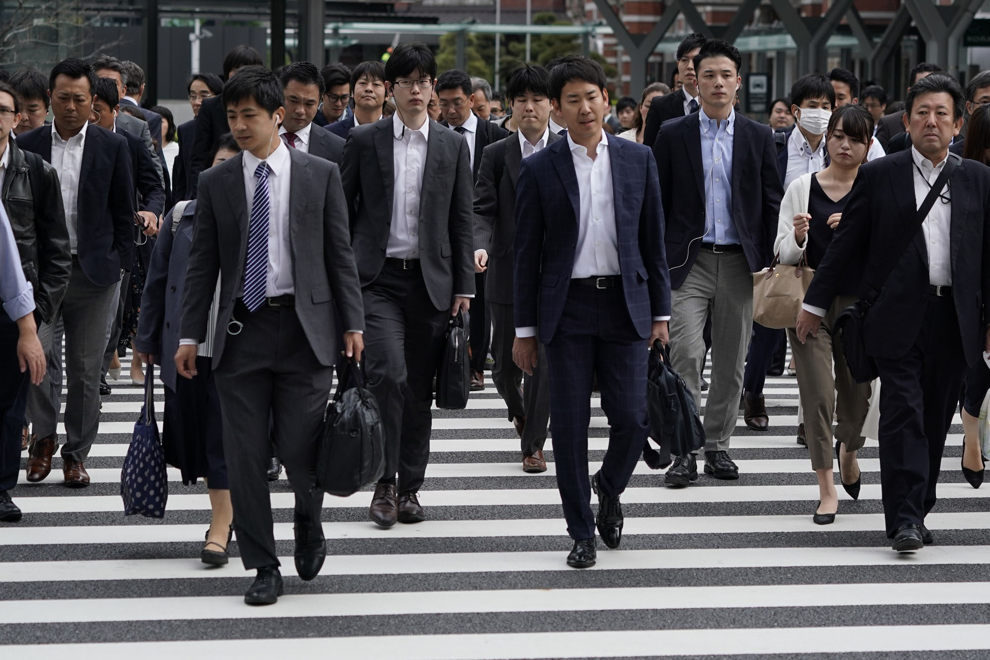 OECD data suggests that as a percentage of corporate value-added, Japanese firms pays the lowest share to employee compensation in the OECD: 32 percent for large listed corporations and 40 percent for small and medium-size ones. In Germany, the figures are 78 and 71 percent, respectively. | BLOOMBERG