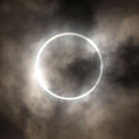 Eclipses allow us to see how space is warped by massive objects like the sun. | BLOOMBERG