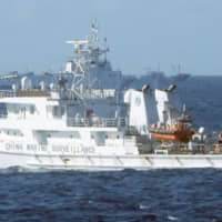 A Chinese government vessel sails in the contiguous zone surrounding the Senkaku Islands in August 2016. Monday marked the 60th consecutive day that China Coast Guard vessels have operated in those waters this year. | KYODO