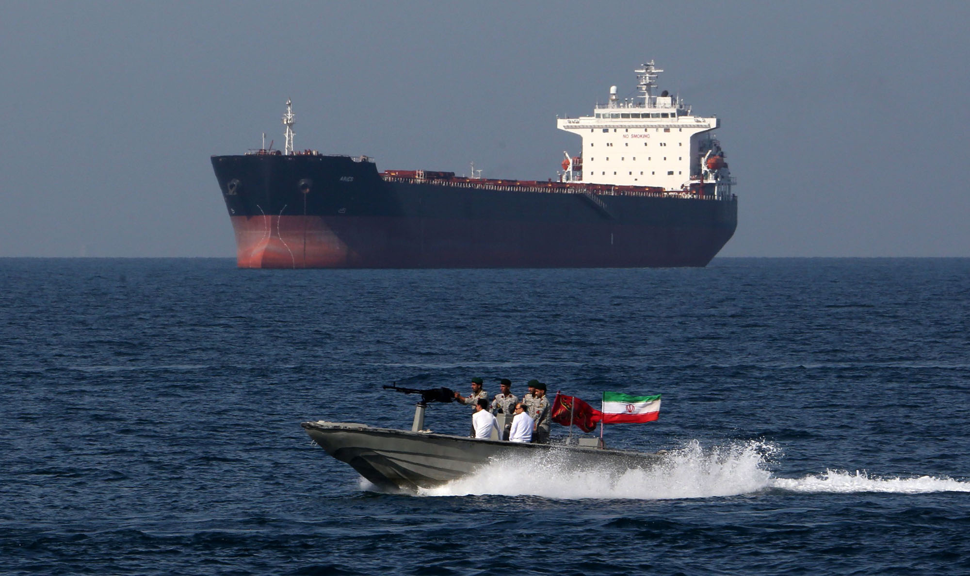 Iranian soldiers take part in 'National Persian Gulf Day' in the Strait of Hormuz on April 19. Iran has dismissed as baseless U.S. accusations that it was involved in last week's attacks on two oil tankers in the Gulf of Oman. | AFP-JIJI