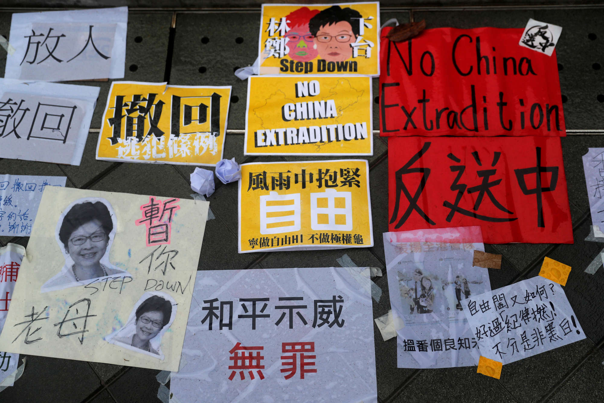 Messages are seen at a demonstration in Hong Kong on Monday demanding that Chief Executive Carrie Lam withdraw a controversial extradition bill and step down.   REUTERS