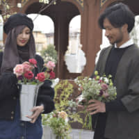 Style Instagrammer Aufa Yazid (left) and her brother, Ghufron Yazid, a flower arrangment artist, at Tokyo Camii in Tokyo | KYODO