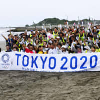 Beach cleanup held at Olympic surfing venue