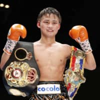 Hiroto Kyoguchi poses after defending his WBA light flyweight title against Tanawat Nakoon on Wednesday in Chiba. | KYODO