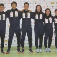 Men's epee's Kazuyasu Minobe (far left) and other national team fencers pose at a news conference for the Asian Fencing Championships at Chiba Port Arena on Wednesday. | KAZ NAGATSUKA