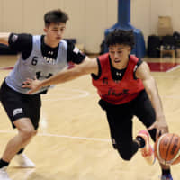 Guard Chikara Tanaka attacks the basket while being guarded by Kai Toews at the Japan men's national development training camp at the National Training Center on Friday. | KAZ NAGATSUKA