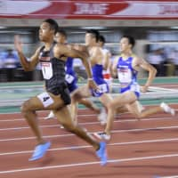 Abdul Hakim Sani Brown sprints to victory in a men's 100-meter semifinal at the Japan National Championships on Thursday in Fukuoka. | KYODO