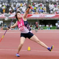 Women's javelin thrower Haruka Kitaguchi competes at the Japan National Championships on Friday in Fukuoka. Kitaguchi won the title with a throw of 63.68 meters.   KYODO