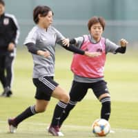 Nadeshiko Japan midfielder Saki Kumagai (left) participates in a recent training session in Paris. Japan faces Argentina in its Women's World Cup opener on Monday. | KYODO