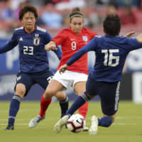 England's Jodie Taylor (center) competes against Japan's Moeka Minami (left) and Arisa Matsubara in a SheBelieves Cup match in March in Tampa, Florida. | AP