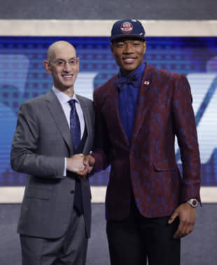 NBA commissioner Adam Silver poses with Rui Hachimura after the Washington Wizards selected him as the ninth pick in the first round of the NBA Draft on Thursday night in New York. | AP