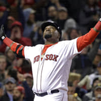 Boston Red Sox designated hitter David Ortiz celebrates his two-run home run against the New York Yankees during the eighth inning of a baseball game at Fenway Park in Boston in 2016. Ortiz was hospitalized Monday following surgery for a gunshot wound after being ambushed by a man in a bar in his native Dominican Republic, authorities said.   AP