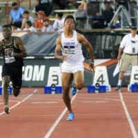 Japanese sprinter Abdul Hakim Sani Brown competes at the NCAA Division I outdoor athletics championships on Friday in Austin, Texas. Sani Brown set a new national record with a time of 9.97 seconds in the men's 100 meters. | AP