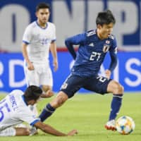 Takefusa Kubo, seen here during his national team debut against El Salvador on Tuesday, is reported to be leaving FC Tokyo to join Real Madrid. | KYODO