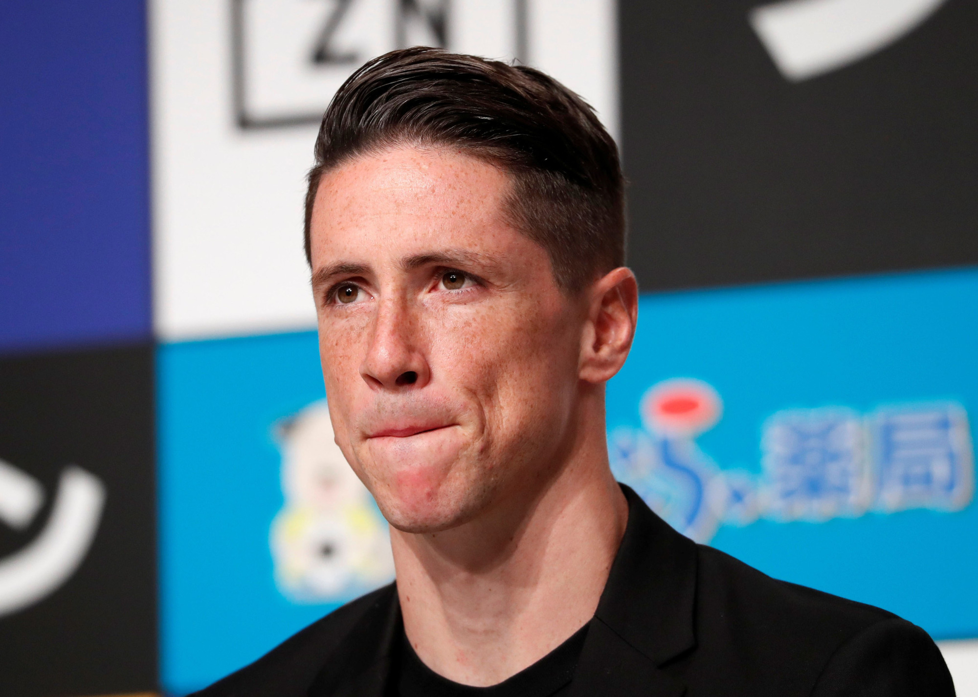 Sagan star striker Fernando Torres faces the media during a news conference to announce his retirement from soccer on Sunday in Tokyo. | REUTERS