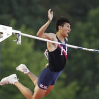 Masaki Ejima competes in the men's pole vault event on Saturday at nationals. Ejima claimed the title with a 5.61-meter mark. | KYODO