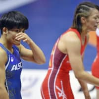 Kaori Icho reacts after her defeat to Risako Kawai in the women's 57-kg final during the national wrestling championships on Sunday at Komazawa Gymnasium. | KYODO