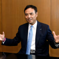 Takeshi Niinami, president and CEO of Suntory Holdings Ltd., talks about the company's strategy on PET bottles in an interview with The Japan Times in Tokyo on May 30. | YOSHIAKI MIURA