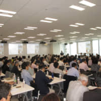 More than 200 people attended the Green Finance symposium organized by GFNJ in Tokyo on May 18. | DAISUKE TAKOH