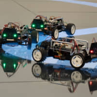 An automated miniature car demonstration at INIAD | TOYO UNIVERSITY