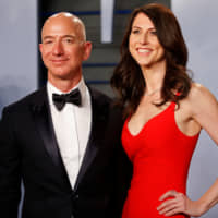 Amazon CEO Jeff Bezos and his then-wife, MacKenzie Bezos, arrive for the Vanity Fair Oscar Party in Beverly Hills, California in April last year. | REUTERS
