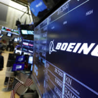 The logo for Boeing appears above a trading post on the floor of the New York Stock Exchange Monday. The company is scheduled to release its second quarter earnings Wednesday. | AP