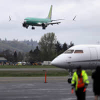 A Boeing 737 Max 8 airplane being built for India-based Jet Airways lands following a test flight in April at Boeing Field in Seattle. Boeing Co. reported earnings on Wednesday. | AP