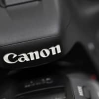 Canon's profit on track to fall by 36%, hit by weak China demand