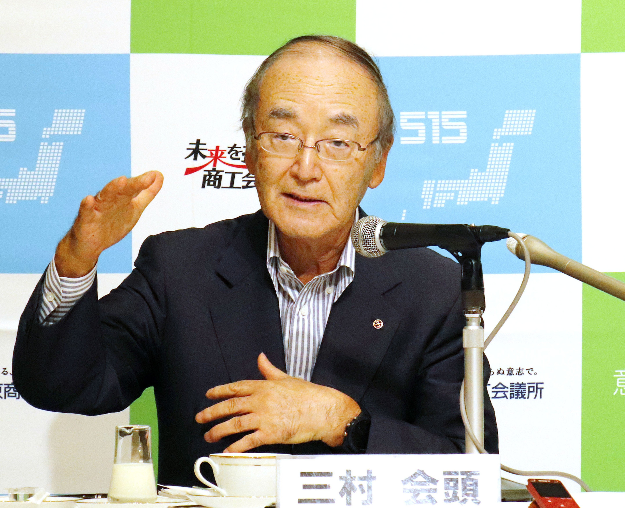 Akio Mimura, head of the Japan Chamber of Commerce and Industry, speaks during a news conference in Tokyo on July 17. | KYODO