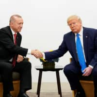 Erdogan says Trump can waive sanctions on Turkey