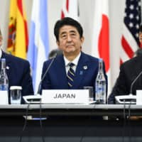 U.S. President Donald Trump, Prime Minister Shinzo Abe and Chinese President Xi Jinping attend a meeting at the Group of 20 summit in Osaka on June 28. | AFP-JIJI