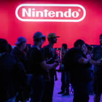 Attendees wait to enter the Nintendo Co. Pokemon Sword and Shield exhibit during the Electronic Entertainment Expo in Los Angeles on June 11. | BLOOMBERG