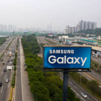 A roadside advertisement for Samsung Electronics Co. Galaxy smartphones in Seoul | BLOOMBERG