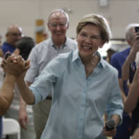 Democratic presidential candidate Sen. Elizabeth Warren greets people as she arrives at a campaign event Saturday in Derry, New Hampshire. | AP