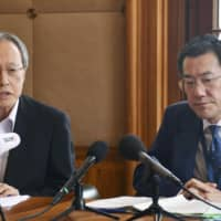 Junichi Ihara (left), ambassador for the Permanent Mission of Japan to the International Organizations in Geneva, and Shingo Yamagami, head of the Foreign Ministry's Economic Affairs Bureau, attend a meeting at the WTO headquarters in Geneva on Wednesday. | KYODO