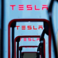 Tesla super chargers are shown in Mojave, California, Wednesday. | REUTERS