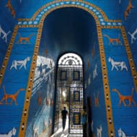A view of a replica of the Ishtar gate in the ancient city of Babylon, near Hilla, Iraq, is seen on Friday. | REUTERS