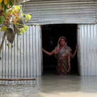 Bangladesh tries doling out cash in advance to aid flood-threatened families