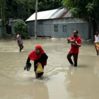 Flooding across third of Bangladesh leaves over 60 dead, displaces hundreds of thousands