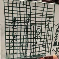 A drawing by children recently released from CBP depicting their time spent in U.S. Customs and Border Protection (CBP) custody, to the Catholic Charities Humanitarian Respite Center in McAllen, Texas, is shown in this image released by the American Academy of Pediatrics in Itasca, Illinois, Wednesday. | COURTESY AMERICAN ACADEMY OF PEDIATRICS / HANDOUT / VIA REUTERS
