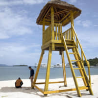 A lookout tower stands on the beach at Dara Sakor resort in the Botum Sakor district of Koh Kong, Cambodia. | BLOOMBERG
