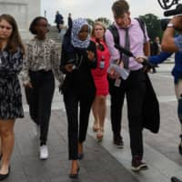 U.S. Rep. Ilhan Omar (center) speaks with reporters after the Democrat controlled House of Representatives passed a resolution condemning President Donald Trump for his 'racist comments' about four Democratic congresswomen the day before, at the Capitol in Washington Tuesday. | AFP-JIJI